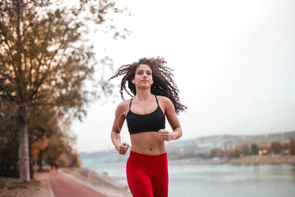 Running with red pants and black bra