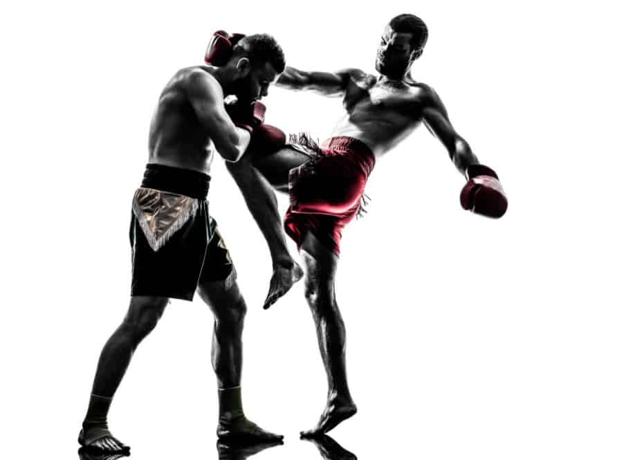 Two men fighting in muay thai style