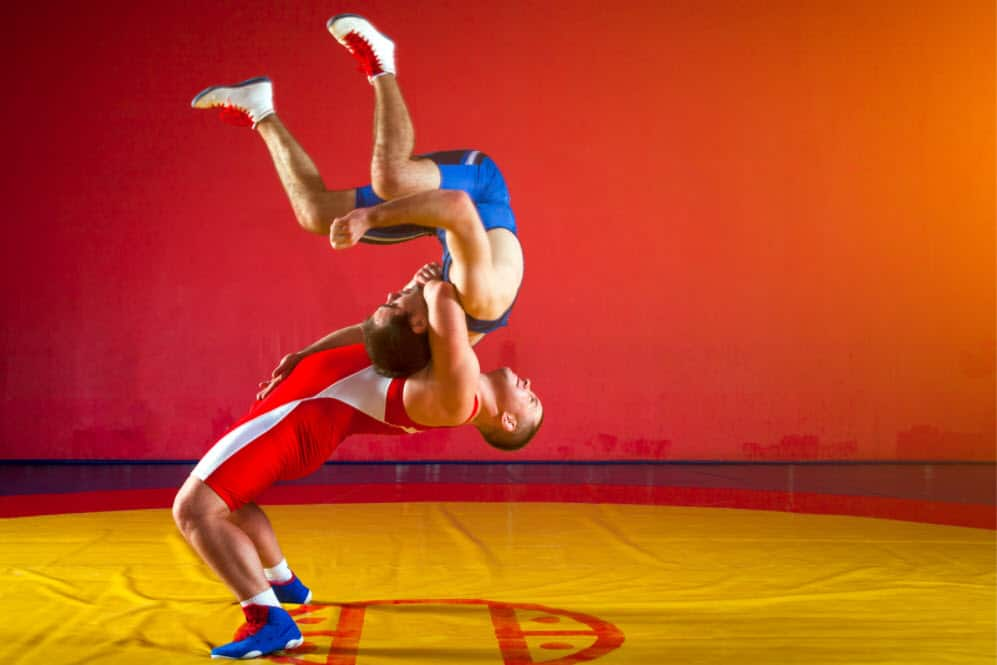 Wrestlers throwing each other after the best protein for wrestlers